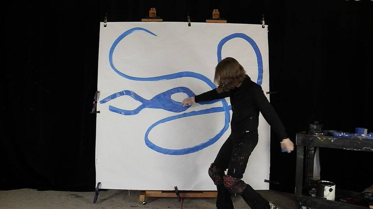 live performance painter JAO painting the initial outlines of a blue bird on a 6 foot by 6 foot canvas