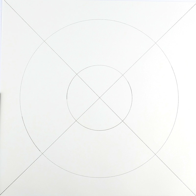 two lines drawn from corner to corner cross at center. Two concentric circles, one large, one small.