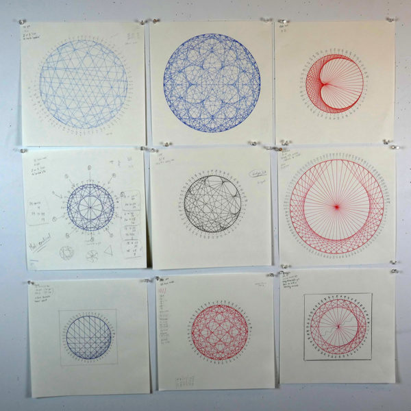 circles with modular math drawings in red, blue and black