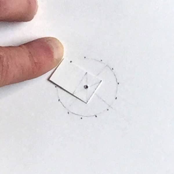 paper cut of of square with golden rectangle placed on top of circle marked with 13 evenly spaced points