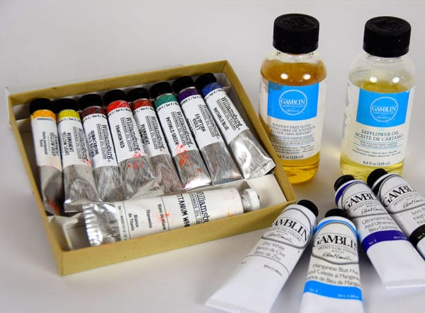 small box of oil paints with 4 oz containers of Gamblin solvent free fluid and safflower oil